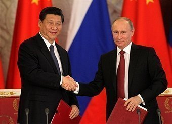Chinese, Russian presidents meet ahead of SCO summit