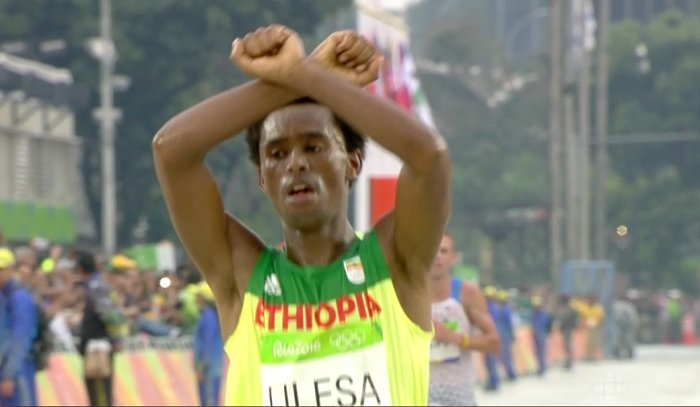 Feyisa Lilessa  after finishing second  at Rio Olympic men's marathon this morning Photo : Screenshot from CBC live stream of men's marathon